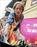 Swedish feminists burn cash