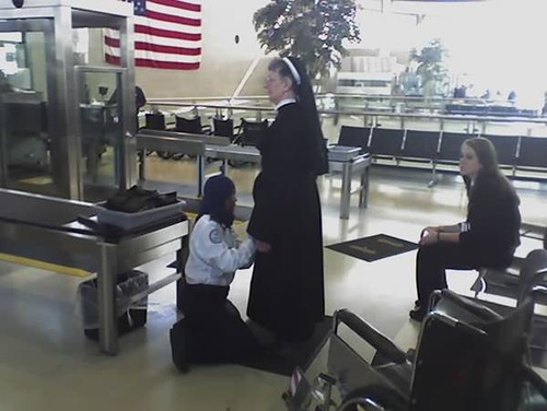 Muslim_customs_agent_frisks_nun